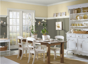 Benjamin Moore's Soleil lifts the mood atop of grey Sparrow and creates sunny harmony in this dining room.
